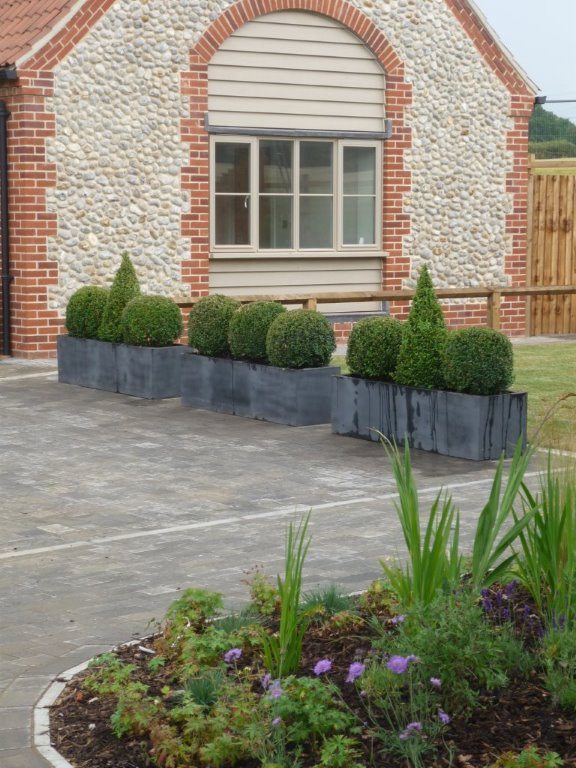 Show home landscaping & faux lead planters, Norfolk