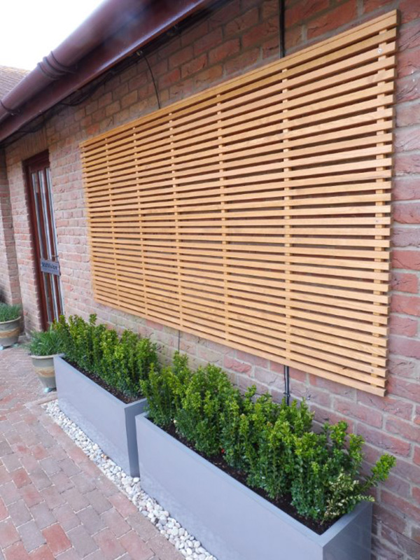 Fibreglass planters with trimmed box, timber wall screens