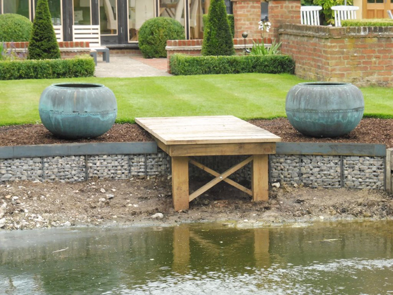 Pond renovation - Oak jetty, stone filled gabions & steel edging