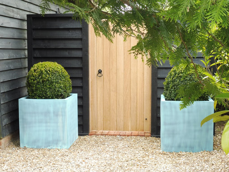 Large weather beaten copper planters, be-spoke Oak gate