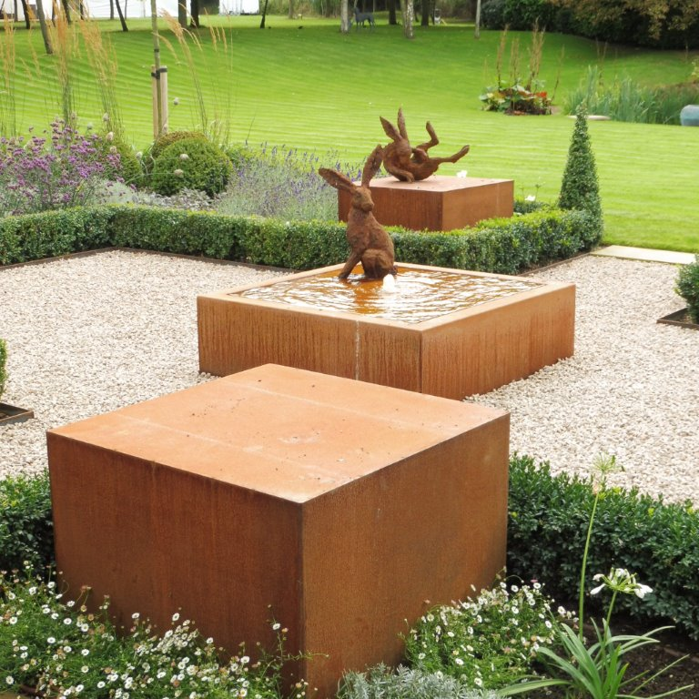 Corten steel cubes & water feature, large hare sculptures