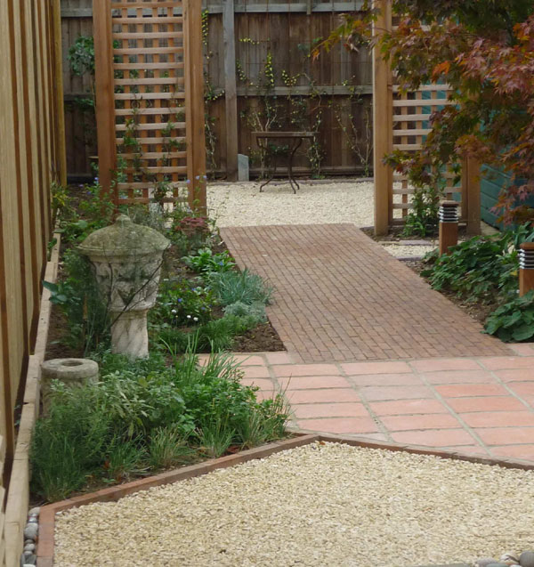 Chippings, terracotta tiles, clay brick pavers, cedar trellis