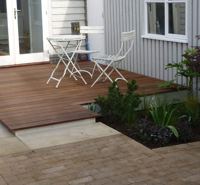 Hardwood decking, sawn Yorkstone and brick pavers